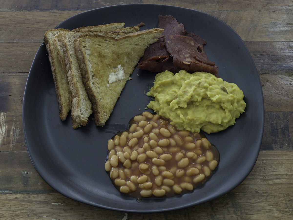 Vegan eggs, vegan bacon, beans and toast